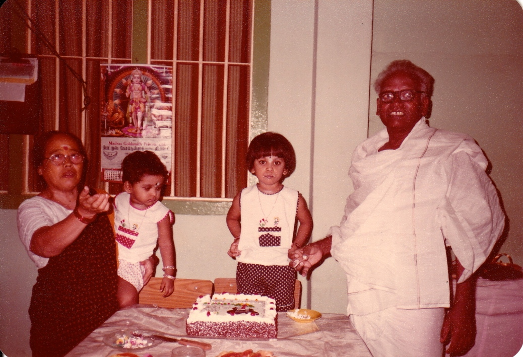 My birthday celebration at the dining area in 44 Joo Chiat Place. (L-R: Grandma, younger sis, me, grandpa) I hated my haircut then!
