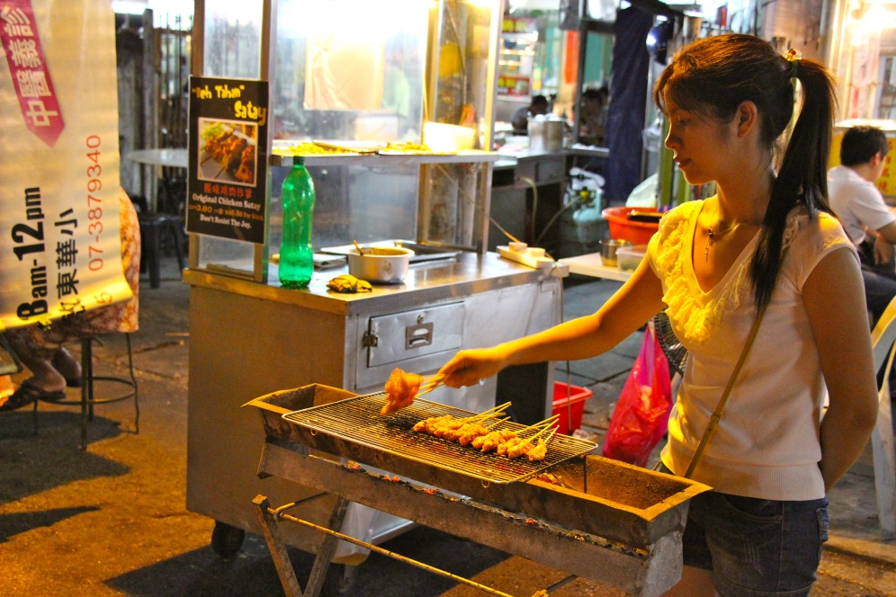 Satay grilling in front of Hokkien Mee stall